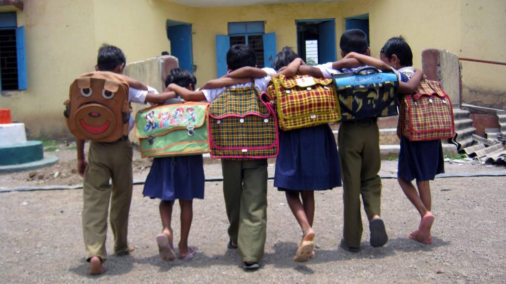 Children-going-to-school-back-shot